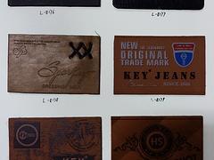 石獅金源發服飾配件提供性價比高的滴膠標產品_供銷滴膠標